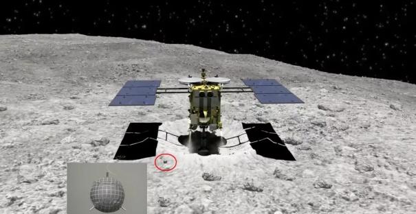 日本隼鸟2号对龙宫小行星采样前,先释放一颗目标标识器,目标标识器落在小行星表面后可以反射光线,帮助下降中的探测器确定位置(图片来源:JAXA)